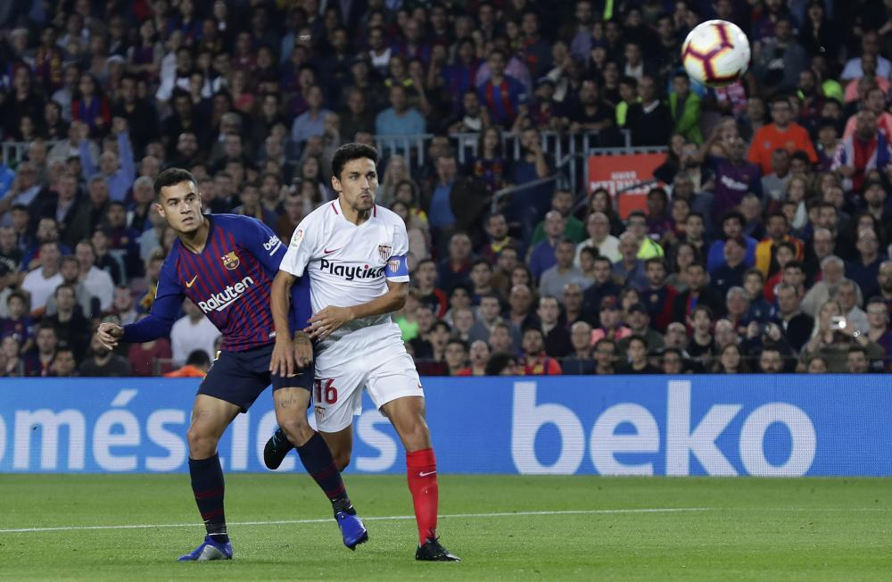 Philippe Coutinho arcs in a brilliant opener as Jesús Navas watches on hopelessly.