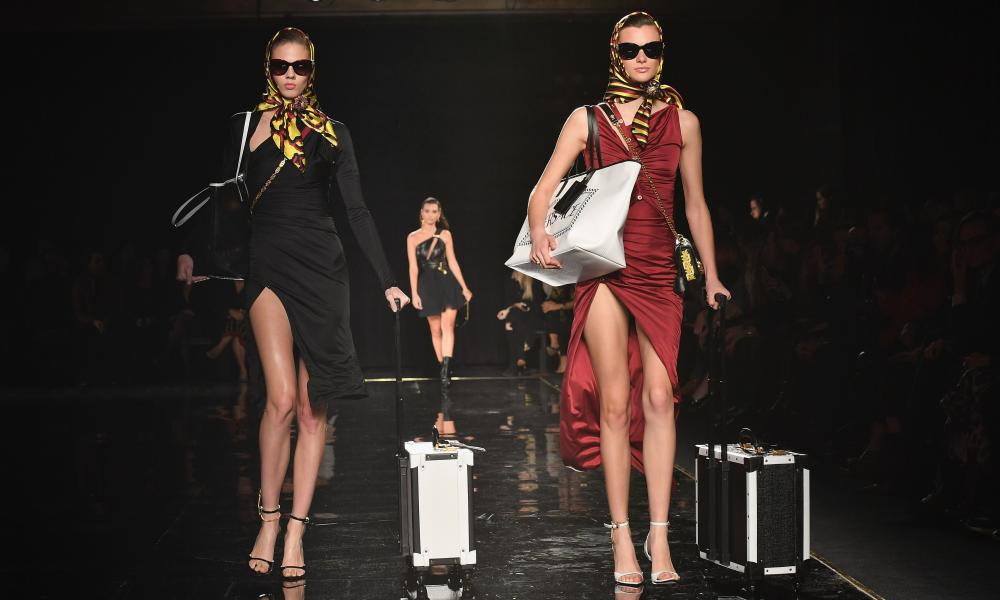 Versace models with carry-on trunks in New York.