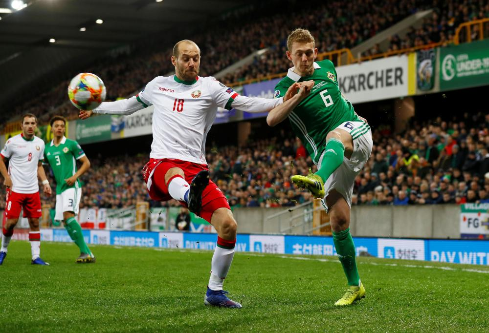 Saville in action for Northern ireland against Maevski for Belarus.