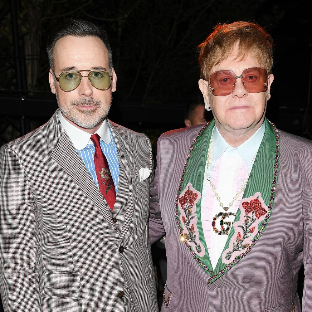 Elton John, who played a gig after the show, with his husband, David Furnish.