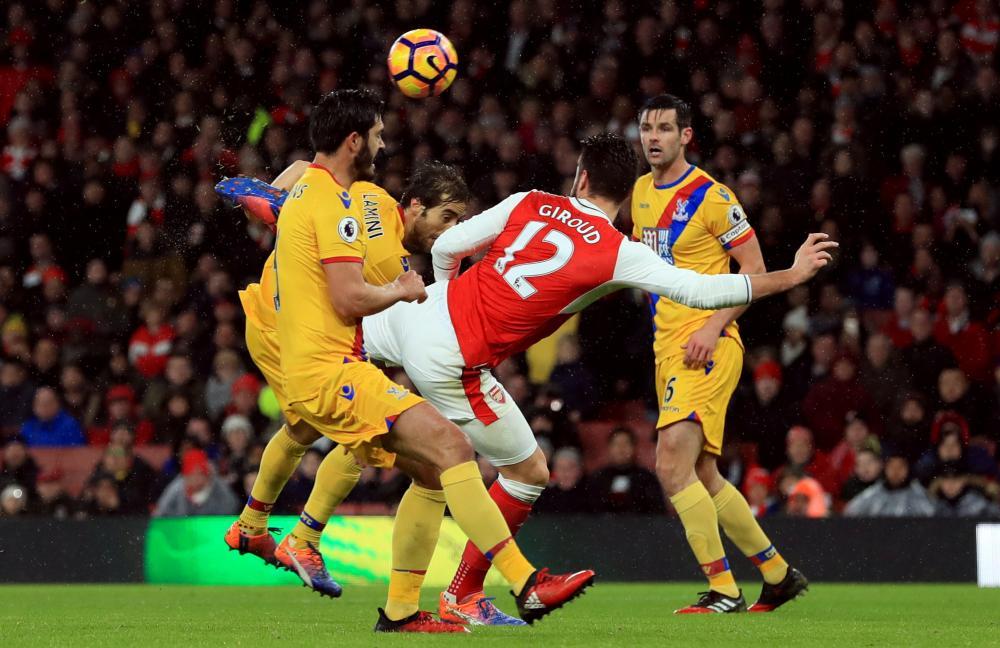 Arsenal's Olivier Giroud scores his stunning goal.