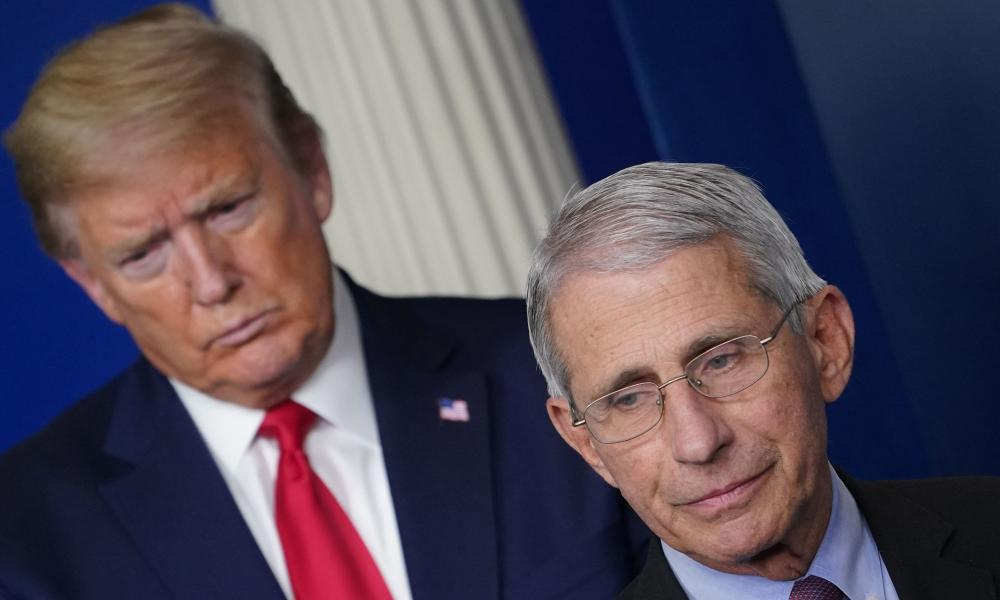 In this file photo Director of the National Institute of Allergy and Infectious Diseases Anthony Fauci, flanked by US President Donald Trump, speaks during the daily briefing on coronavirus.