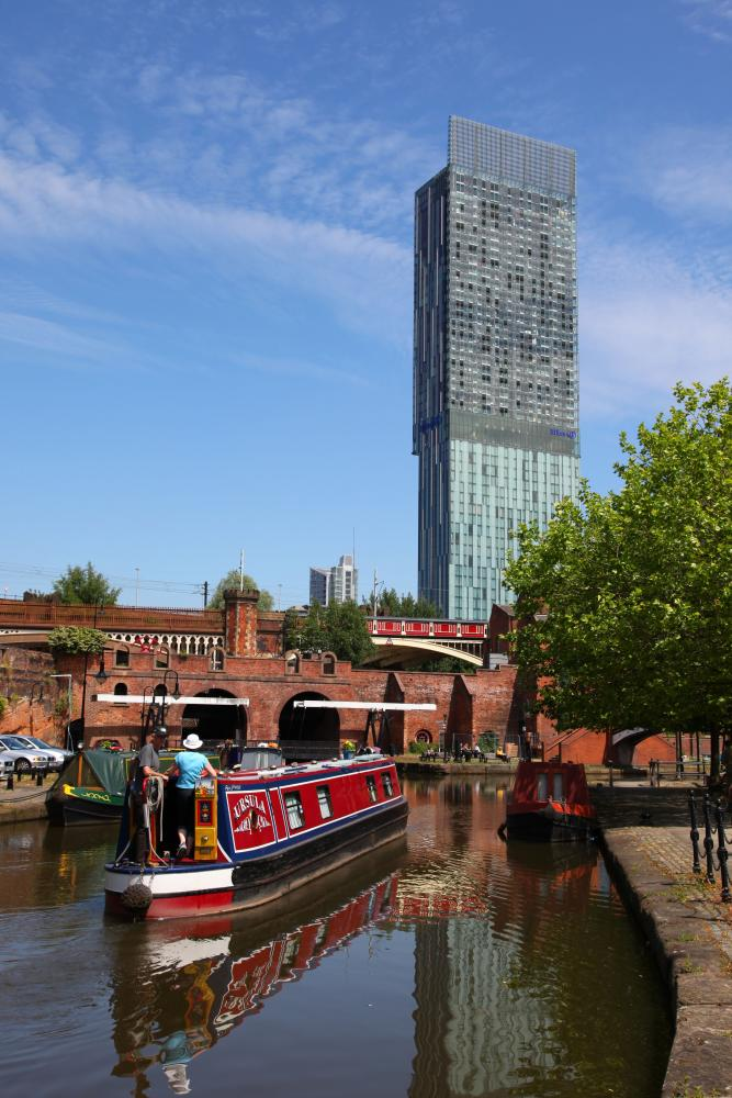 Manchester's Beetham Tower looms above the Bridgewater canal.