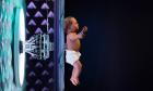 A lifelike baby opens the Robots exhibition at the Museum of Science and Industry
