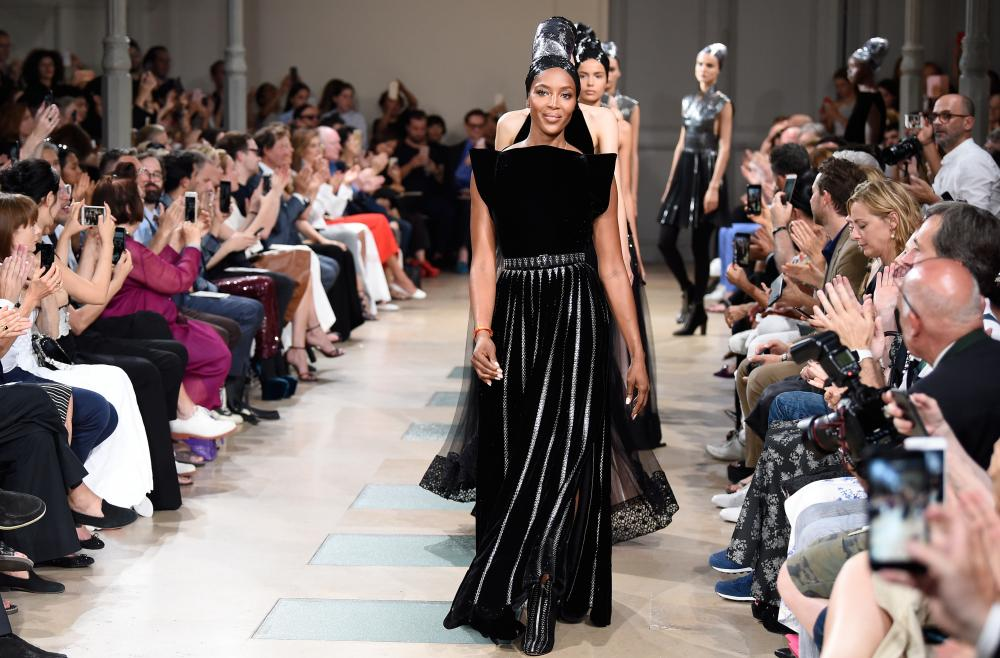 Naomi Campbell walks the runway for Azzedine Alaïa at haute couture fashion week in Paris in July.