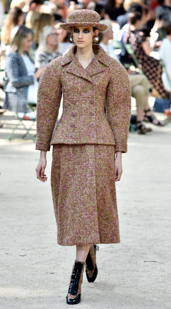 Oversized jackets with patent ankle boots on the Chanel couture catwalk.