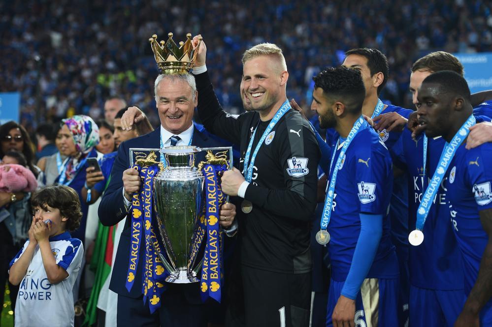 Claudio Ranieri and Kasper Schmeichel celebrate winning the league title.