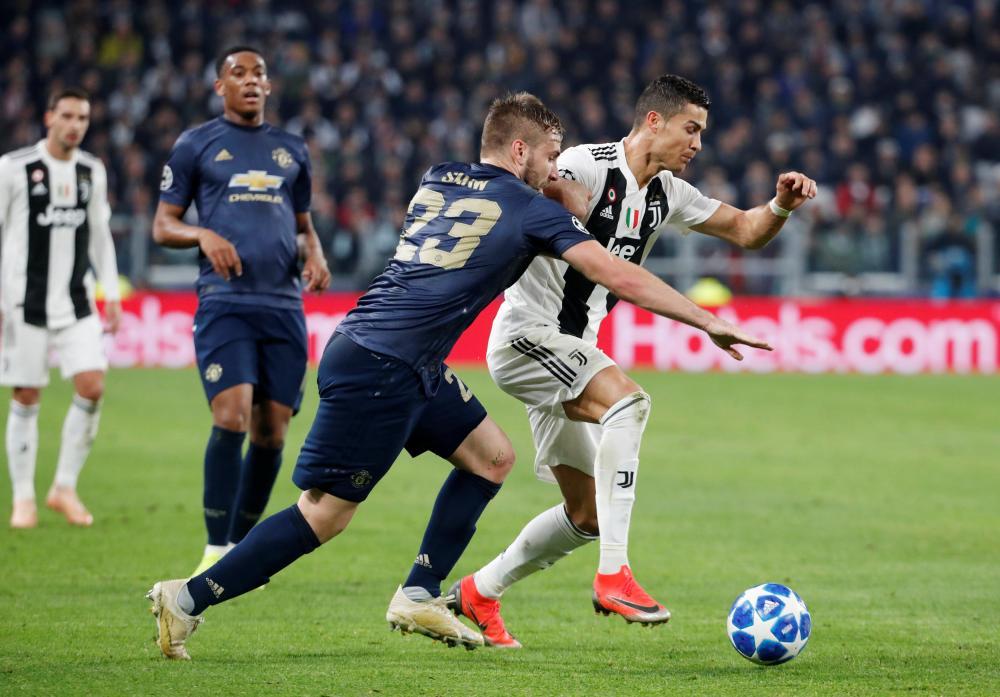Ronaldo goes past Shaw.