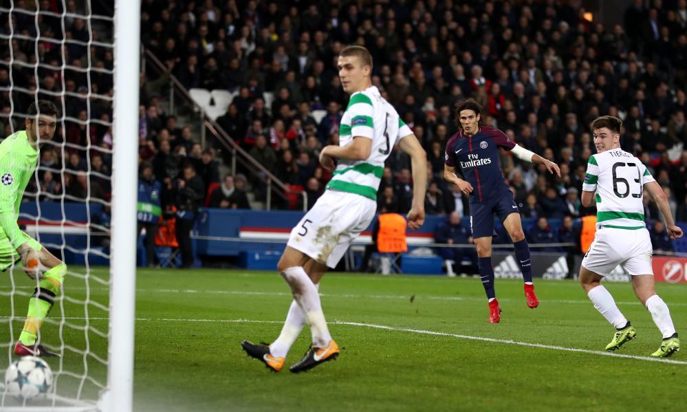Edinson Cavani of PSG scores his sides sixth goal.