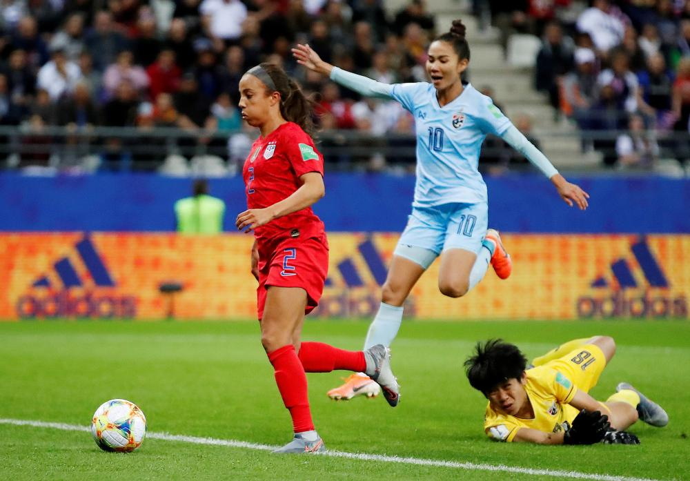 Mallory Pugh rounds the Thailand keeper before slotting the ball into the net for the US's eleventh goal.