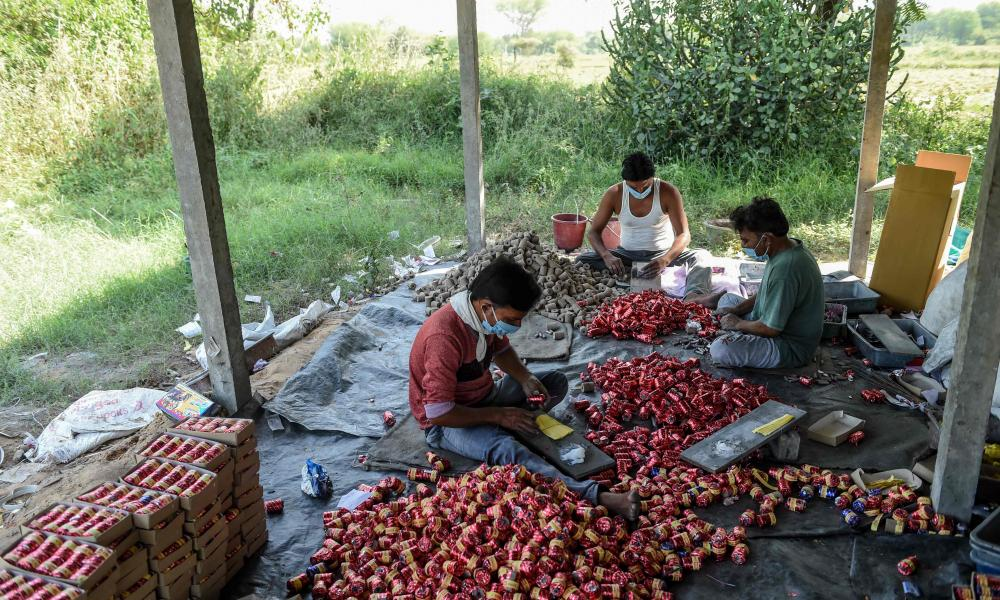 Workers prepare firecrackers at Sonic Fireworks in Vaanch village, some 20 kms from Ahmedabad on 23 October 2020, ahead of the Hindu 'Diwali' festival or the Festival of Lights.