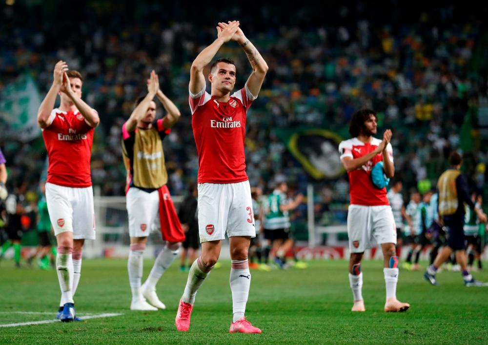 Xhaka applauds their fans after winning the match 1-0.