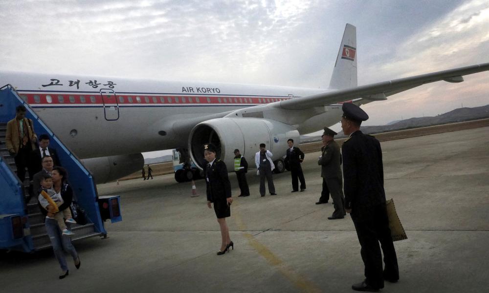 Passengers disembark from an Air Koryo flight in Pyongyang, North Korea.