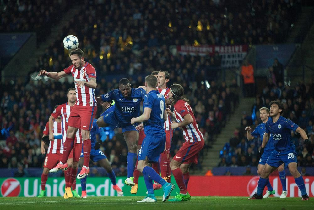 Saul Niguez heads clear from Wes Morgan and Jamie Vardy.