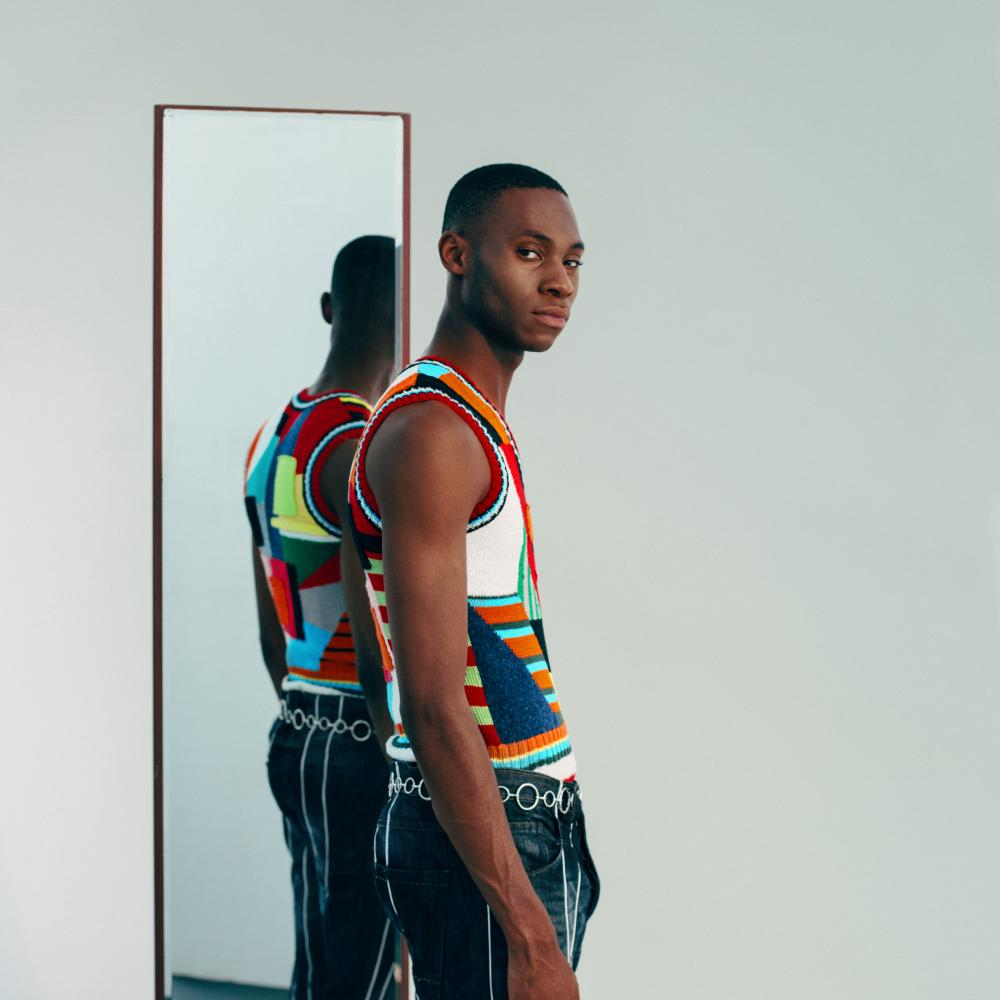 Black male model in recycled Ahluwalia clothing