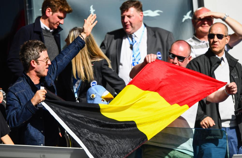 Noel Gallagher celebrates with a Belgian Flag given to him by Vincent Kompany.