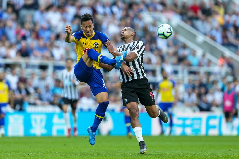 Maya Yoshida of Southampton clears the ball to safety under pressure from Jose Salomon Rondon of Newcastle United.
