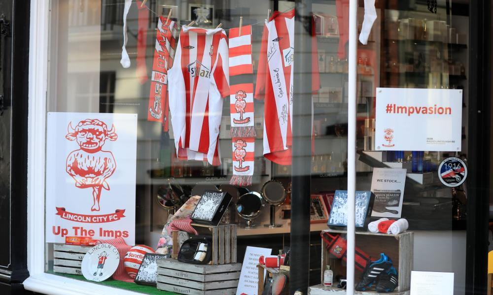 Lincoln City memorabilia displayed in a shop window in the centre of the city.