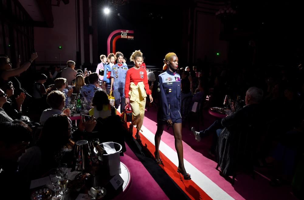 Models walk the runway during Miu Miu Cruise Collection