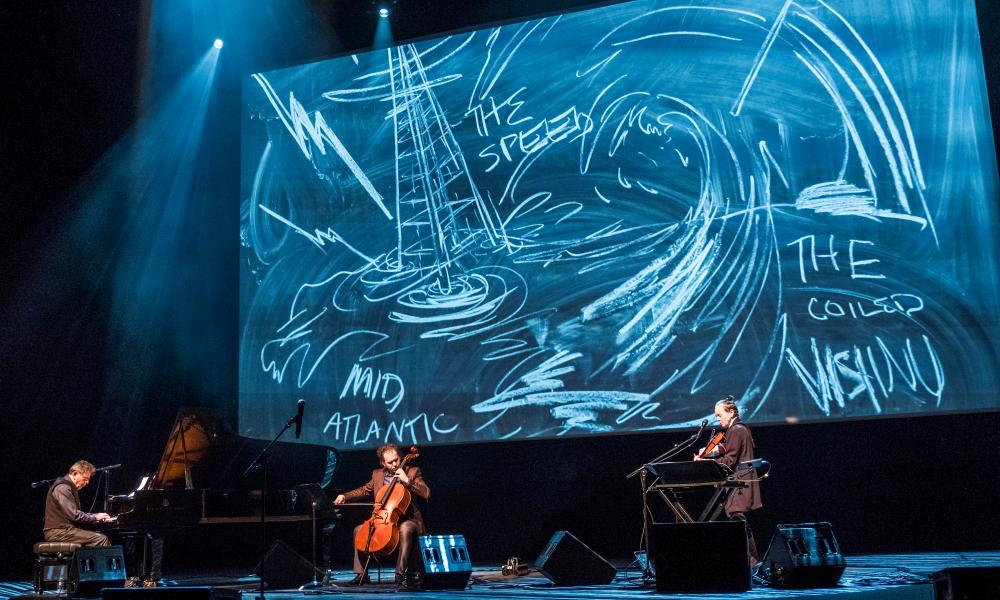 Philip Glass, left, cellist Rubin Kodheli and and Laurie Anderson, right, at the Royal Festival Hall, London.