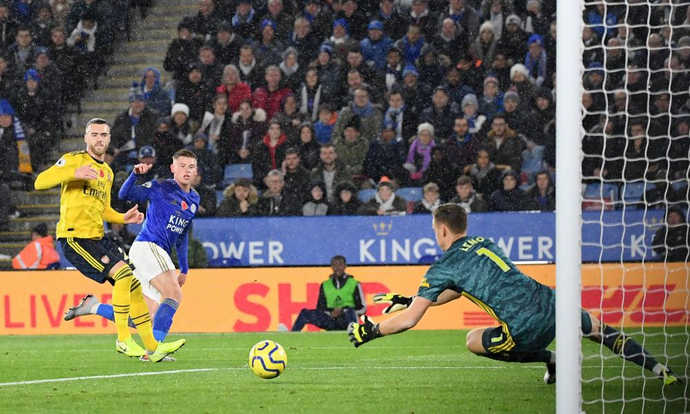 Harvey Barnes of Leicester City shoots under pressure from Calum Chambers of Arsenal.