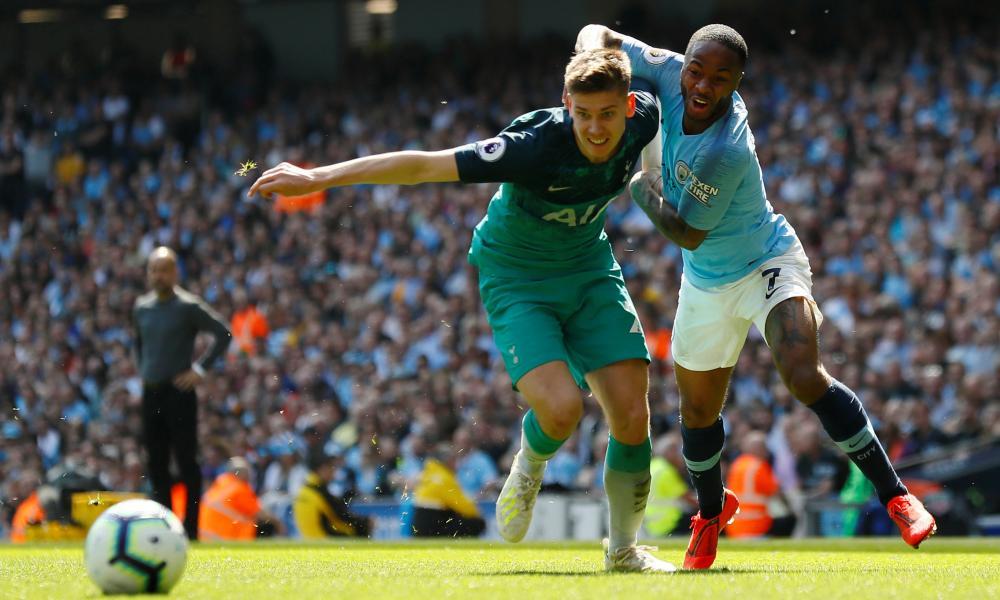 Tottenham's Juan Foyth tussles with Manchester City's Raheem Sterling.