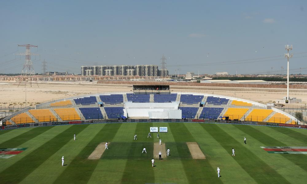 England take to field after lunch during the first Test against Pakistan at Sheikh Zayed Cricket Stadium in Abu Dhabi.