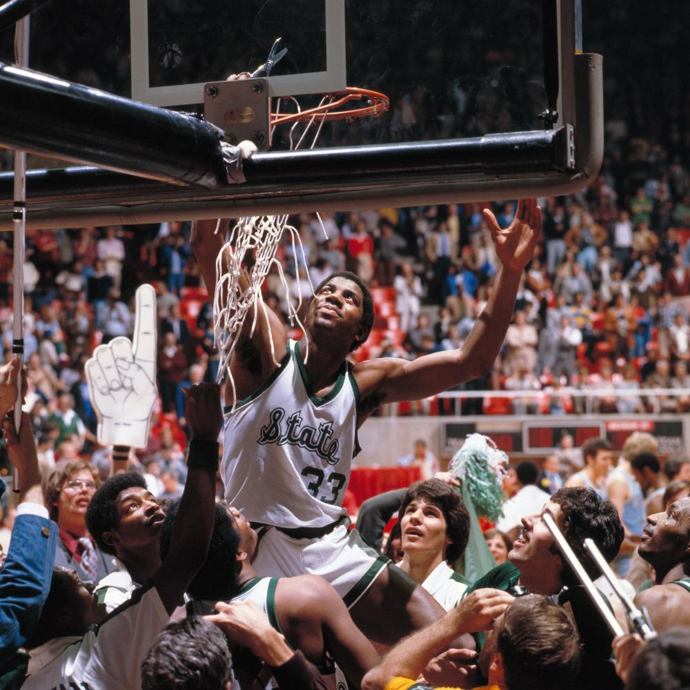 As guard for Michigan State, Johnson cuts down the net after winning a championship game in Salt Lake City in 1979.