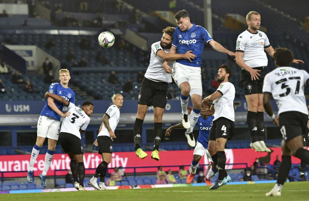 Everton's Michael Keane scores the opening goal.