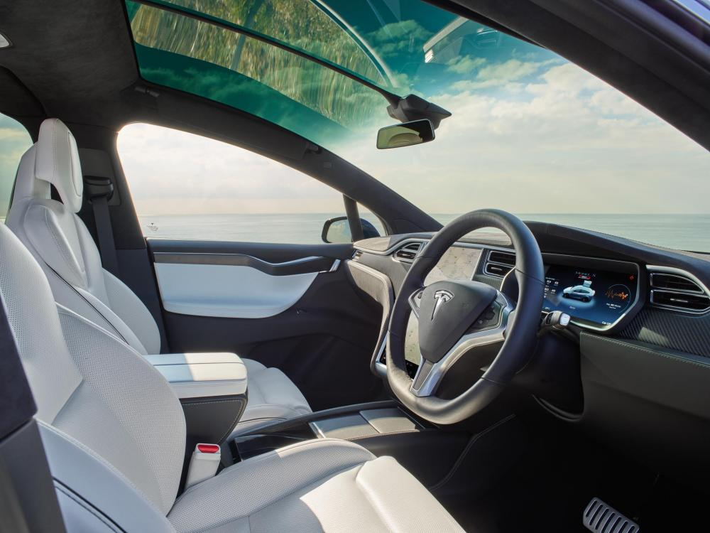 Up front: the huge windscreen of the Model X means the cabin is flooded with light. Note also the 17in touchscreen and digital dashboard