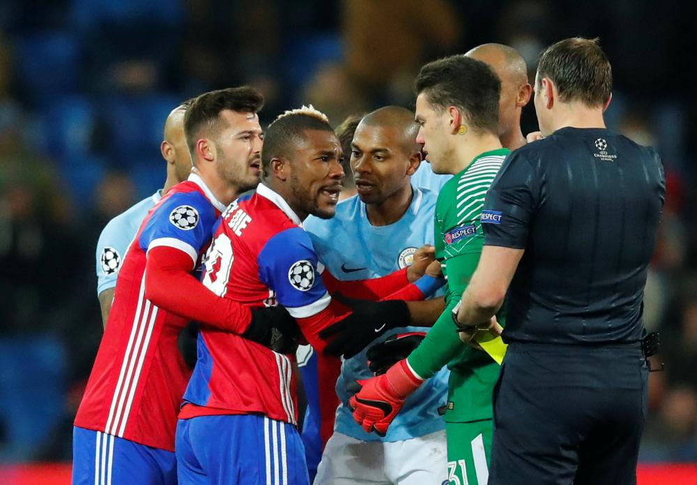 Basel's Serey Die clashes with Ederson.