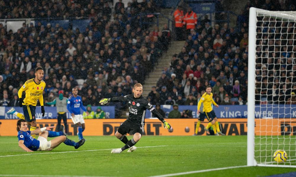 Pierre-Emerick Aubameyang of Arsenal puts the ball past Leicester keeper Kasper Schmeichel but it is disallowed.
