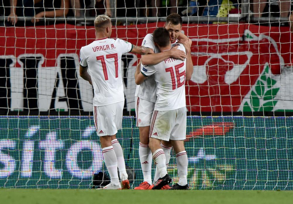 Hungary's Mate Patkai (right) celebrate scoring with his teammates Adam Szalai (centre) and Roland Varga.