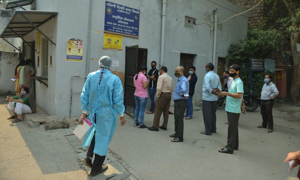 People wait to be tested at the Municipal Corporation dispensary Coronavirus Testing centre in Delhi, India, 28 Oct 2020.