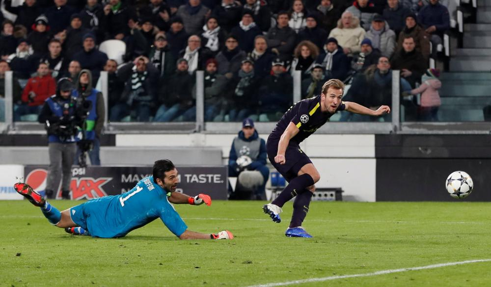 Harry Kane takes the ball around Buffon and slots home.