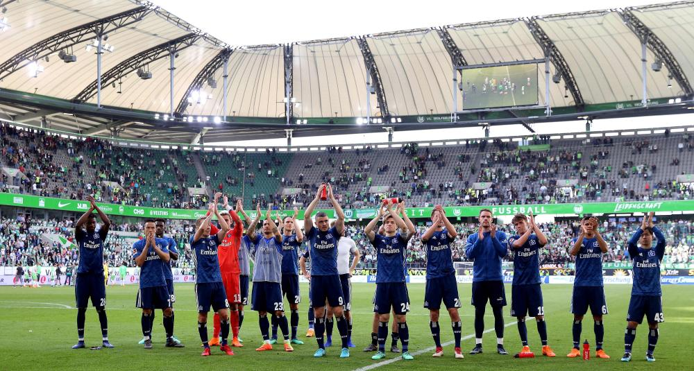 Hamburg players applaud their fans after seeing off Wolfsburg.