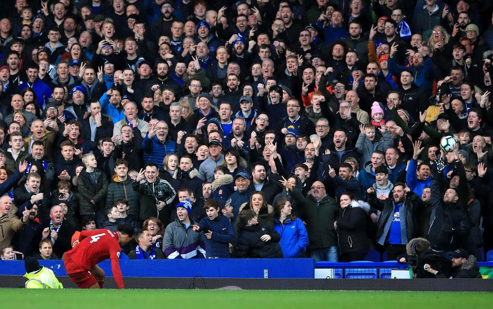 March 3: Liverpool's Virgil van Dijk is jeered by the Everton fans at Goodison Park.