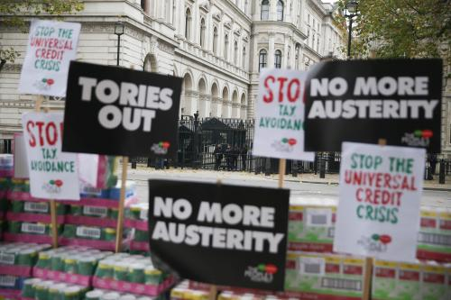 Campaigners protest against government austerity programmes next to crates of tinned food destined for food banks outside Downing street in central London on November 21, 2017. / AFP PHOTO / Daniel LEAL-OLIVASDANIEL LEAL-OLIVAS/AFP/Getty Images