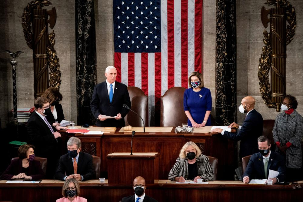 Nancy Pelosi Mike Pence take part in a joint session of Congress to certify the 2020 election results on Capitol Hill in Washington, US.