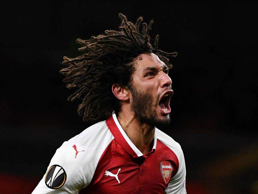 Arsenal's Mohamed Elneny celebrates scoring their sixth goal .