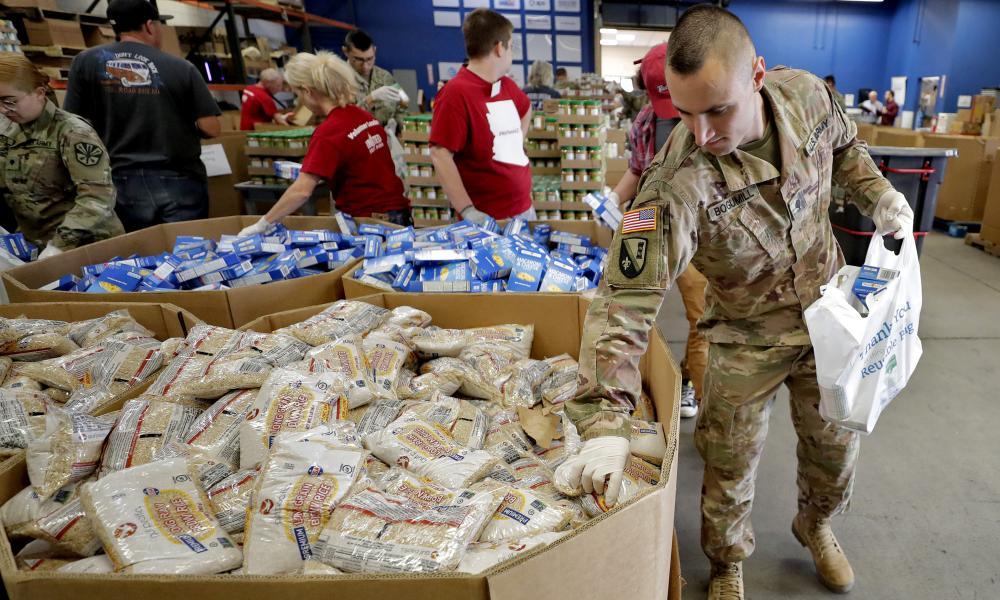 Arizona national guard members pack and sort food items at a food bank in Mesa, Arizona.