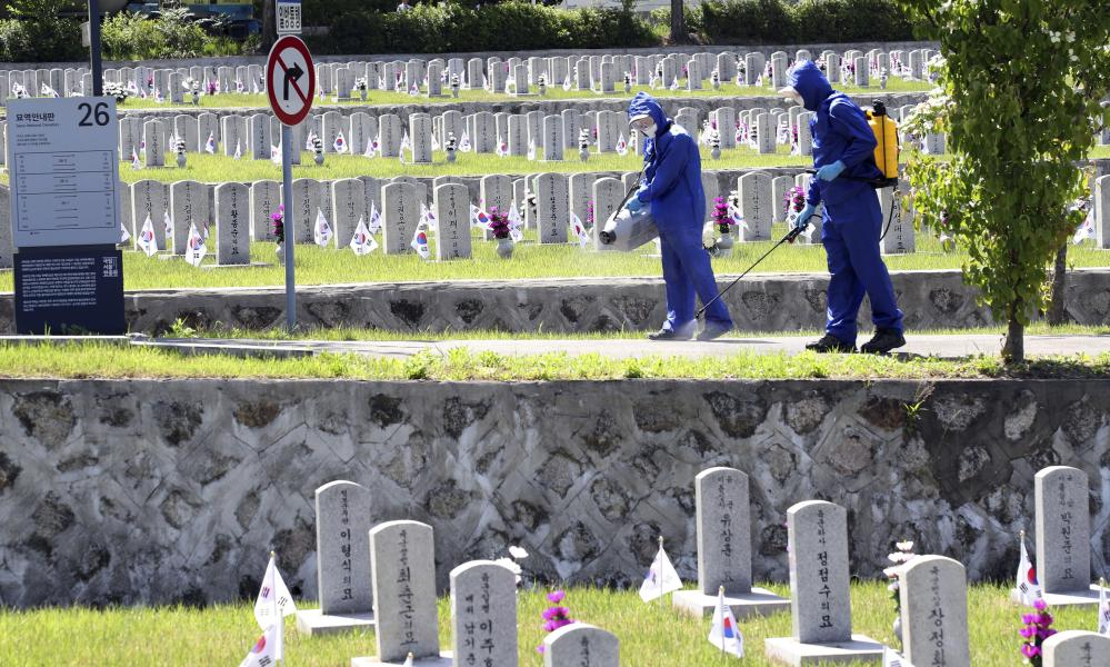 Quarantine officials disinfect as a precaution against the new coronavirus at the National Cemetery in Seoul, South Korea, Monday, 1 June 2020.