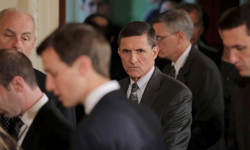 Michael Flynn, middle, is a central figure in the FBI's investigation into whether the Kremlin worked with the Trump campaign to sway the US election.