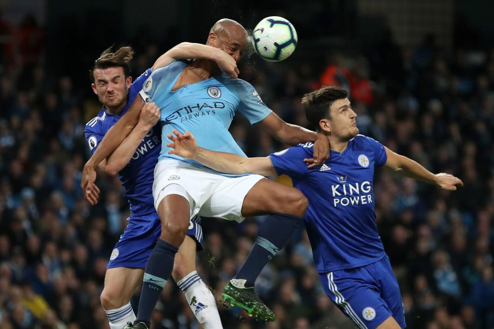 May 6: Manchester City's Vincent Kompany and Leicester's Ben Chilwell and Harry Maguire battle for the ball.