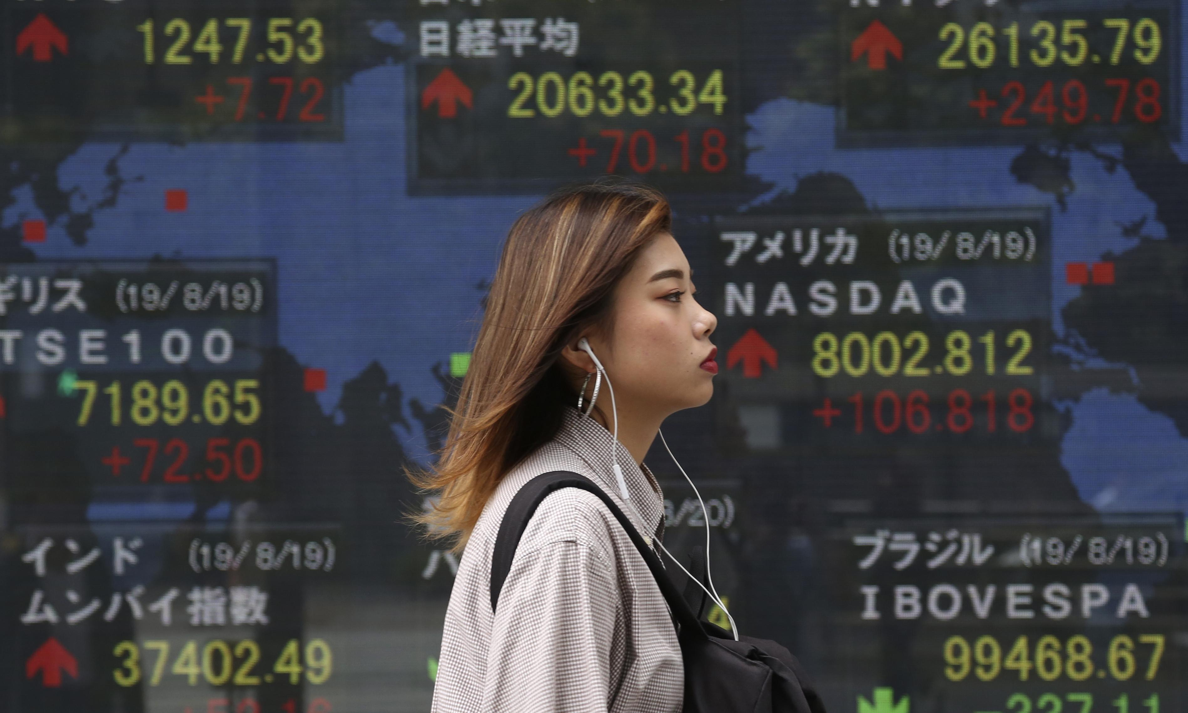 World stocks rally as Trump steps up pressure on Fed to cut rates