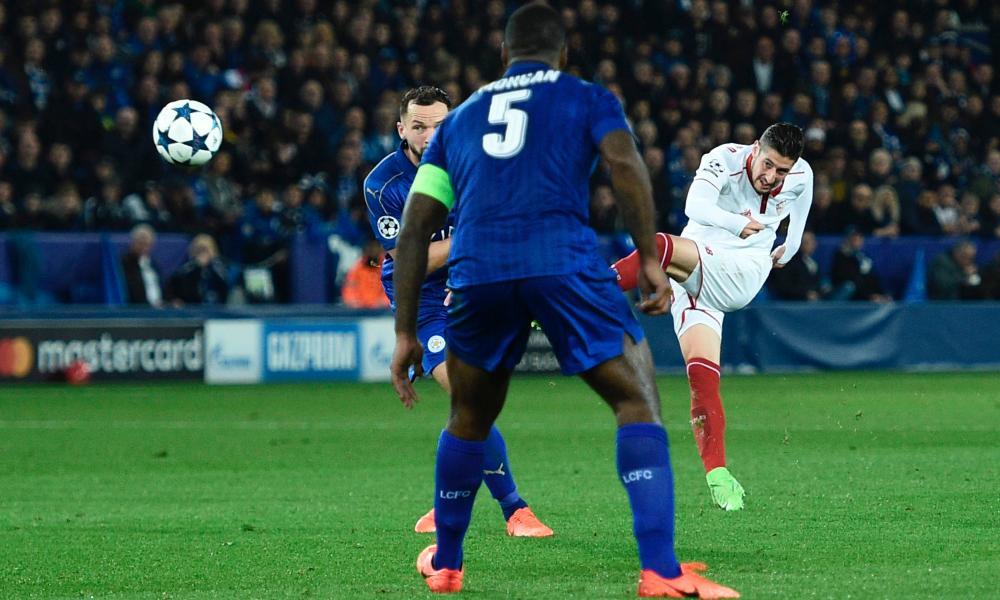 Sevilla's defender Sergio Escudero smacks a shot against the bar.
