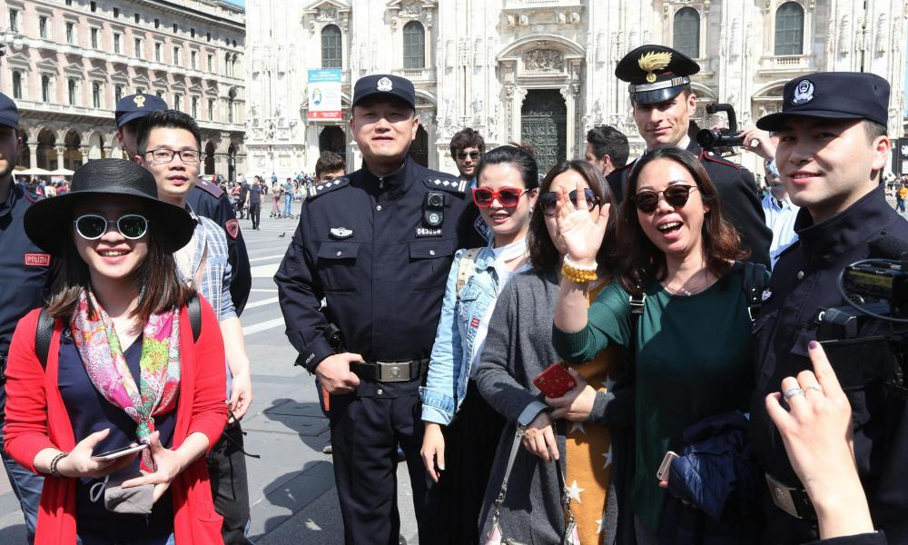 Italian and Chinese police pose with tourists in Milan.