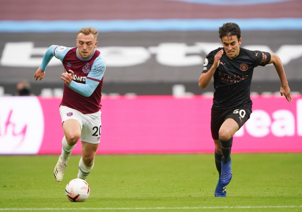Eric Garcia of Manchester City chases Jarrod Bowen of West Ham.