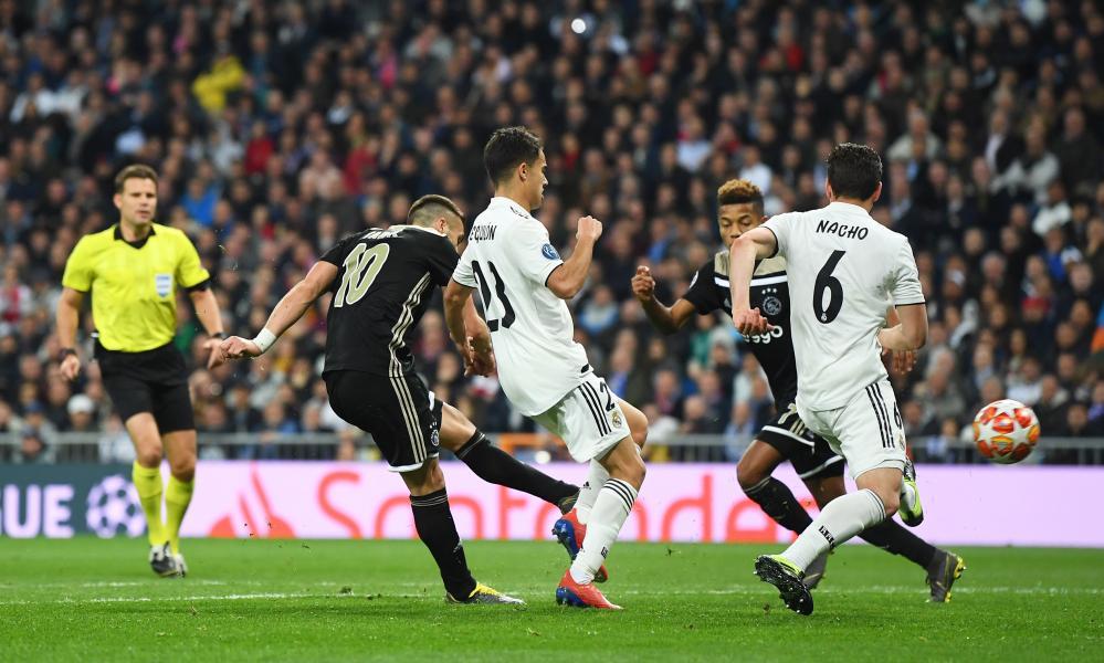 Dusan Tadic sublime finish gives Ajax their third goal on the night.