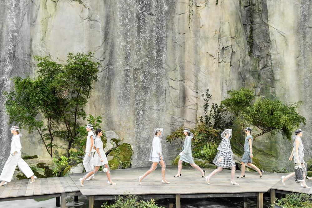 Models, wide shot, walk the runway during the finale of the Chanel Paris show